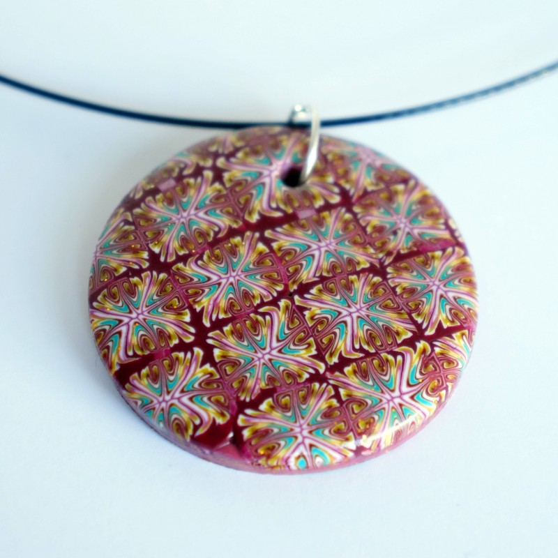 Pendentif rond rouge, turquoise et blanc