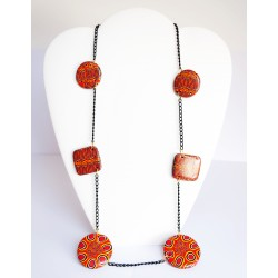 Long orange necklace with black chain and handmade beads