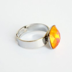 Square orange solitaire ring with pink tones