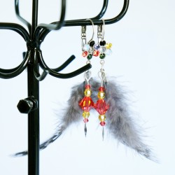 Earrings with gray feathers...