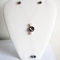 Sautoir noir et blanc en perles en cristal et polaris