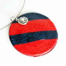 Round red and navy blue pendant.