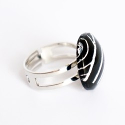 Small black ring with white stripes