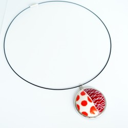 Round pendant with polka dots and scribbles
