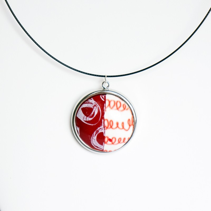 Round pendant with circles and spirals