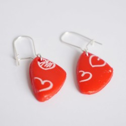 Red earrings with white hearts