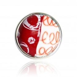 Bague rouge et blanche avec cercles et spirales
