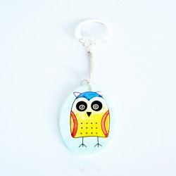 Yellow owl on a sky blue background keyring