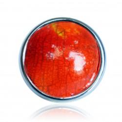 Bague orange craquelée et reflets métalliques